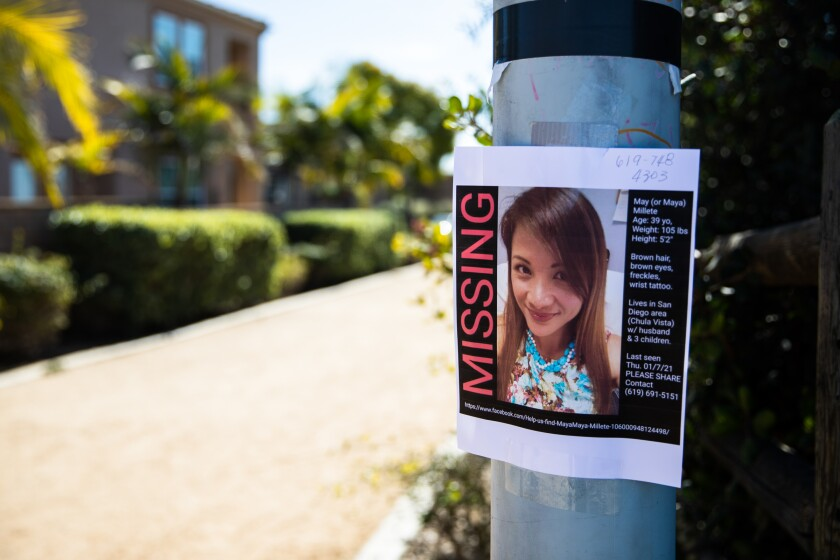 """A missing poster of Maya """"May"""" Millete is seen at the Mother Miguel Mountain Trailhead on Wednesday, Jan. 13."""