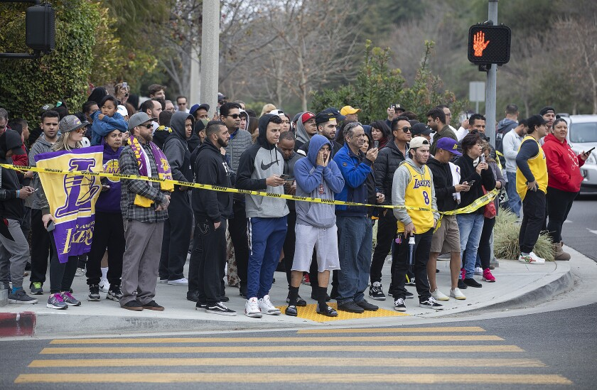 People gather in Calabasas near the scene of Sunday's helicopter crash.