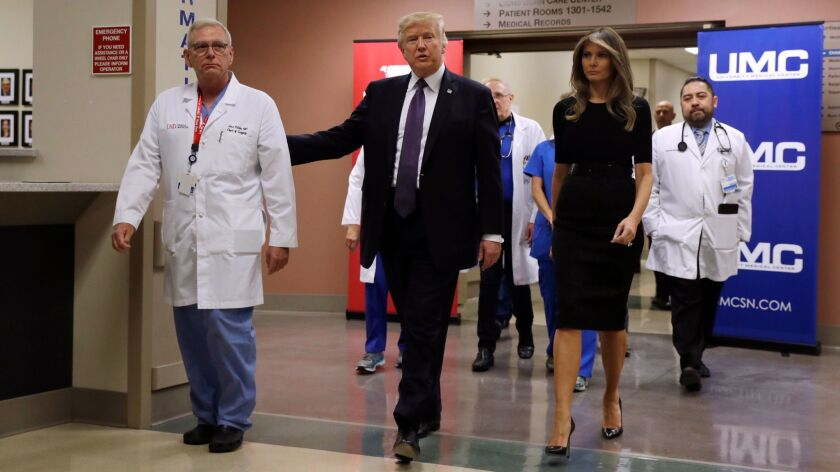 President Trump and First Lady Melania Trump with Dr. John Fildes, a surgeon at University Medical Center in Las Vegas, after meeting with survivors of the mass shooting.