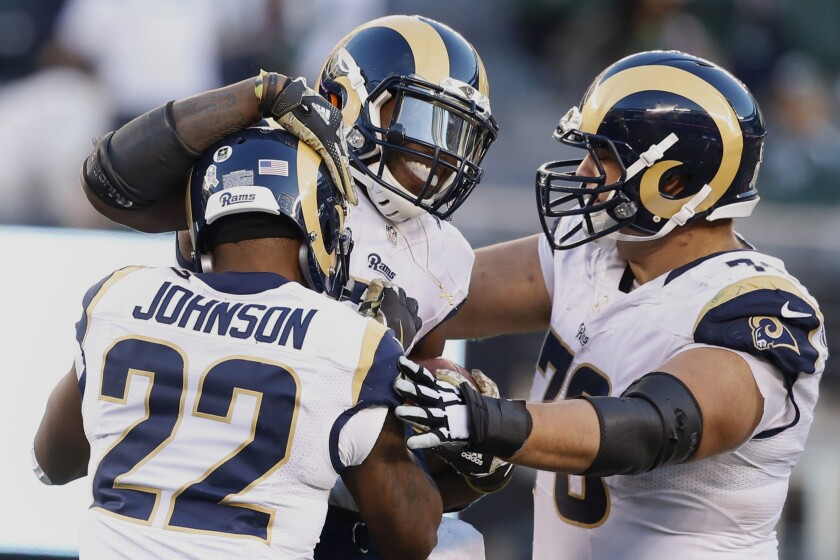 Rams linebacker Alec Ogletree celebrates with teammates Trumaine Johnson and Rob Havenstein, right, after intercepting a pass from Jets quarterback Bryce Petty late in the fourth quarter.
