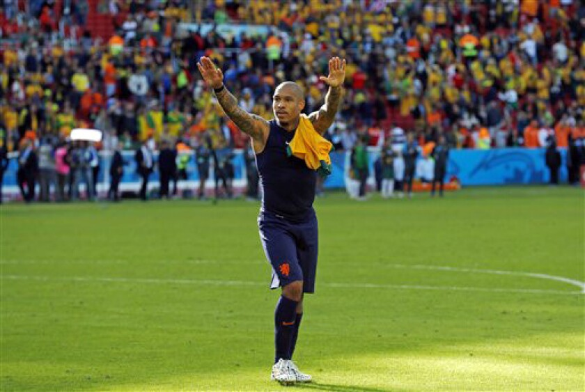 Nigel de Jong greets spectators after the group B World Cup soccer match between Australia and the Netherlands on June 18, 2014.