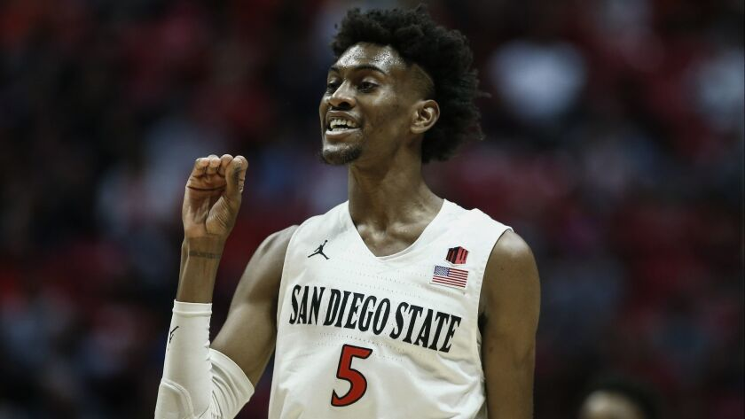 San Diego State forward Jalen McDaniels (5) gestures to UNLV forward Joel Ntambwe (not pictured) as the pair exchange words during the first half of game Saturday at Viejas Arena.