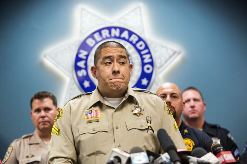 Det. Jorge Lozano of the San Bernardino County Sheriff's Department speaks at a Dec. 8 news conference, recounting his role in responding to the shootings at the Inland Regional Center on Dec. 2.