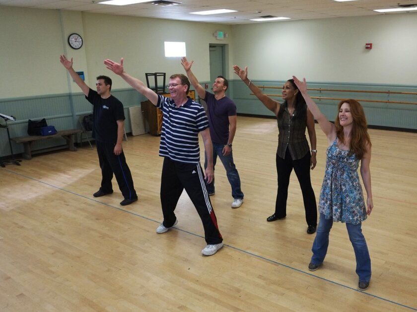 """Jason Webb, director John Vaughan, Eddie Egan, Anise Ritchie and Misty Cotton rehearse a scene from Moonlight Stage Productions' """"The Who's Tommy."""""""