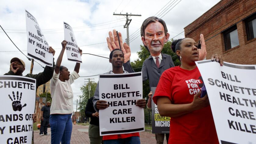 Service Employees International Union members protest at a campaign event for Michigan Atty. Gen. Bill Schuette in Detroit on Oct. 4. Schuette is running for governor against Democratic candidate Gretchen Whitmer.
