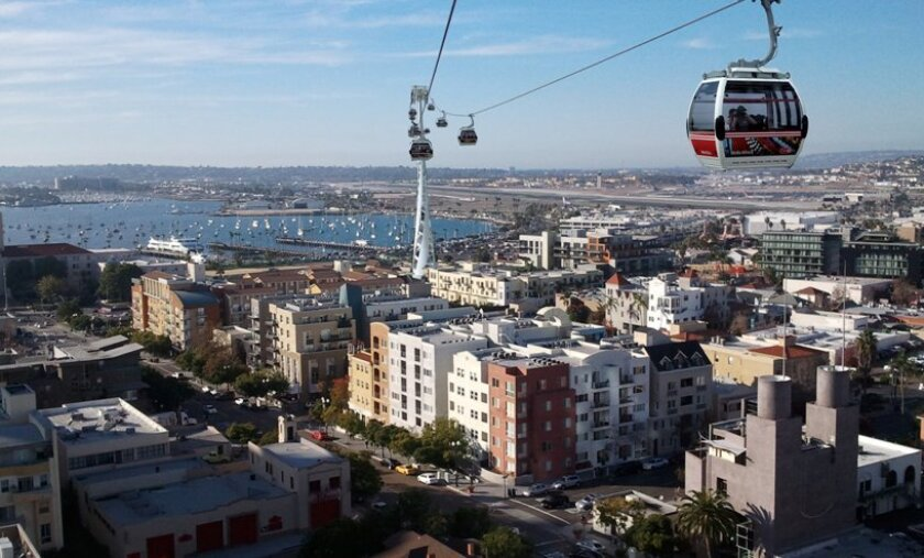 In this photo mashup, an aerial gondola is superimposed onto a view down Cedar Street toward the County Administration Center. It's an idea from urban designer Howard Blackson for linking San Diego Bay and Balboa Park in a fun and entertaining way -- and to reduce car trips with an alternative tran