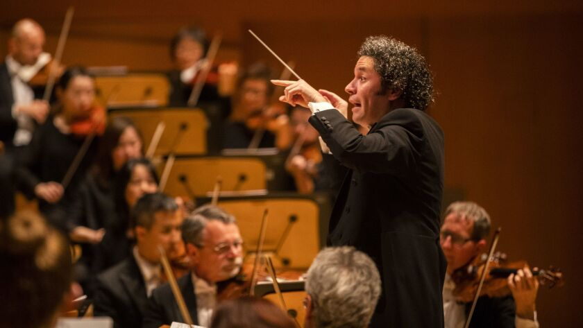 """Gustavo Dudamel conducts a program that pairs Beethoven's Ninth Symphony with Leonard Bernstein's """"Chichester Psalms"""" Thursday at Walt Disney Concert Hall."""