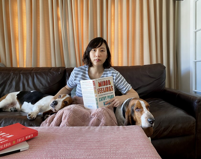 """Author Steph Cha sheltering in place with her two basset hounds and Cathy Park Hong's """"Minor Feelings: An Asian American Reckoning."""""""
