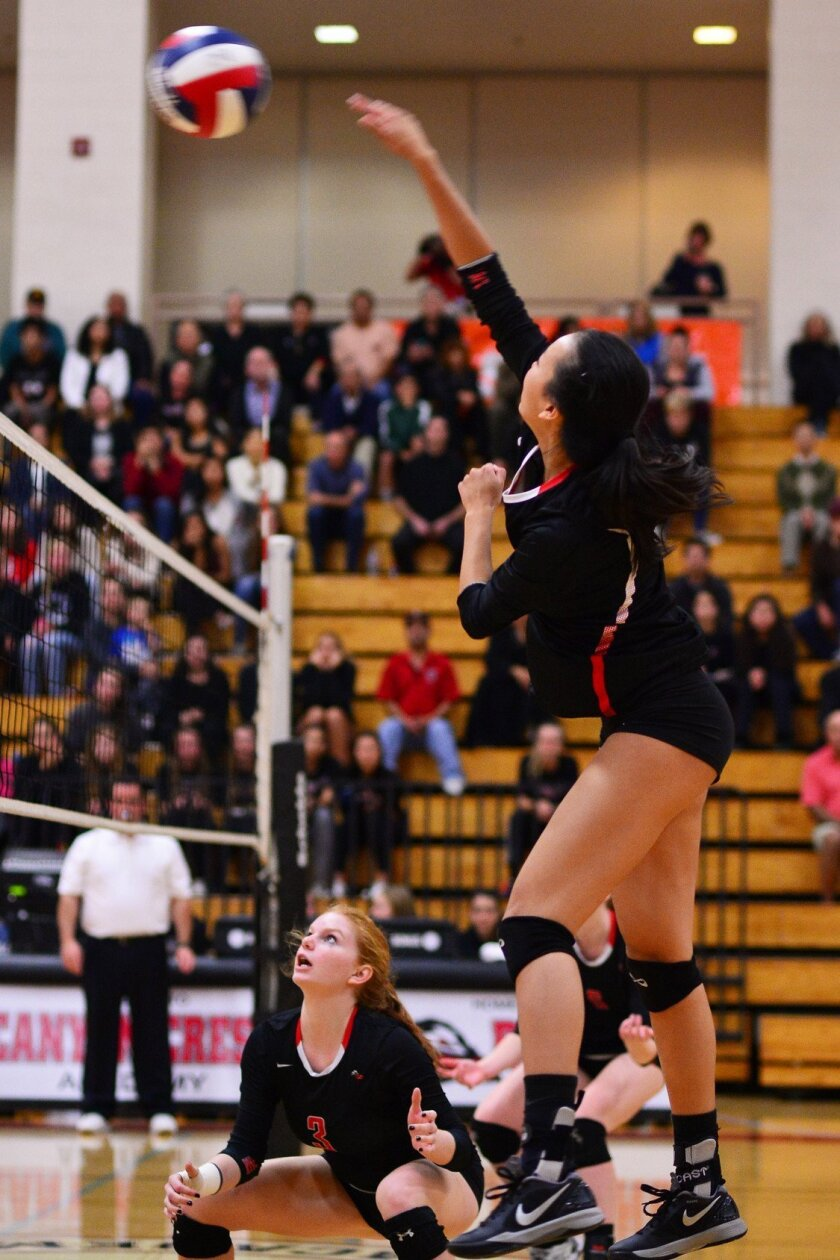 Ashley Sung in action on the volleyball court. 