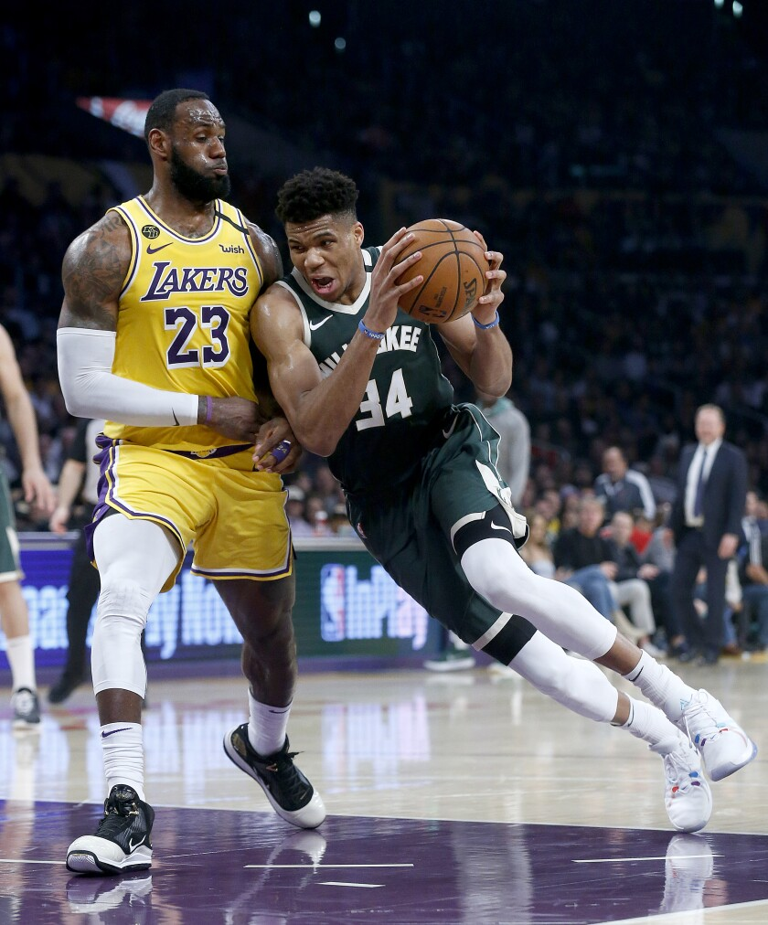 The Lakers' LeBron James defends the Bucks' Giannis Antetokounmpo on March 6, 2020, at Staples Center.