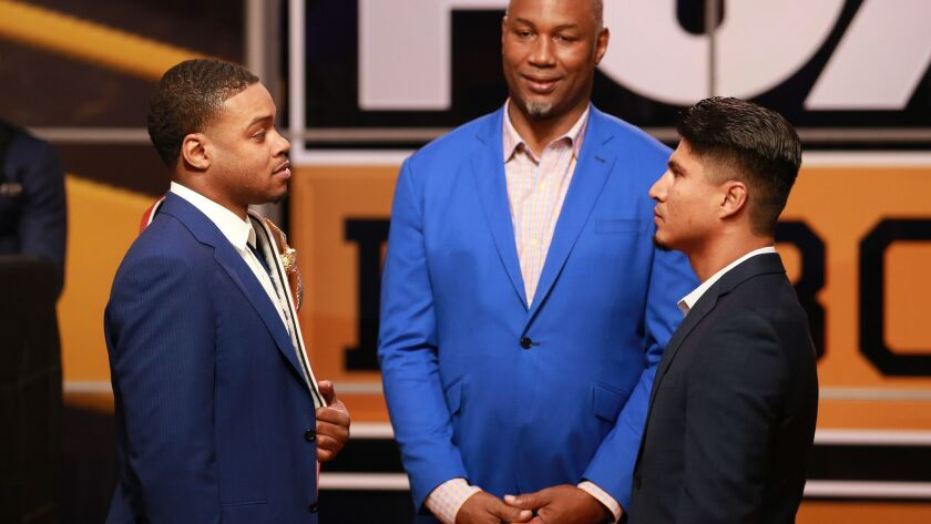 Errol Spence Jr. and Mikey Garcia face off at the announcement of their 2019 fight by FOX Sports and Premier Boxing Champions on Tuesday in Los Angeles. Former champion Lennox Lewis also was in attendance.