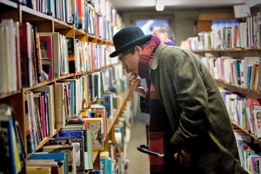 Zack Wentz looked over used books at Wahrenbrock's Book House. At its peak, Wahrenbrock's collection of more than 250,000 volumes filled three floors.