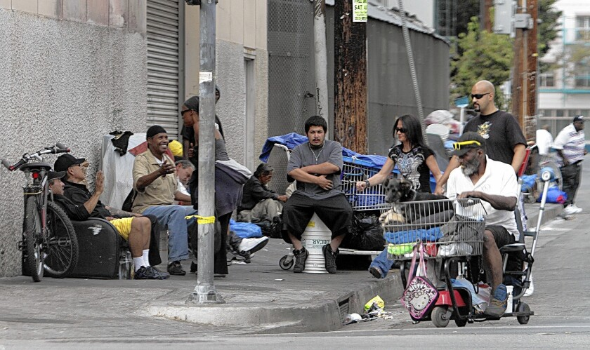 Homeless people with their belongings along streets in L.A.'s skid row. The city administrator's proposal would expand bathroom and storage options for the area's homeless.