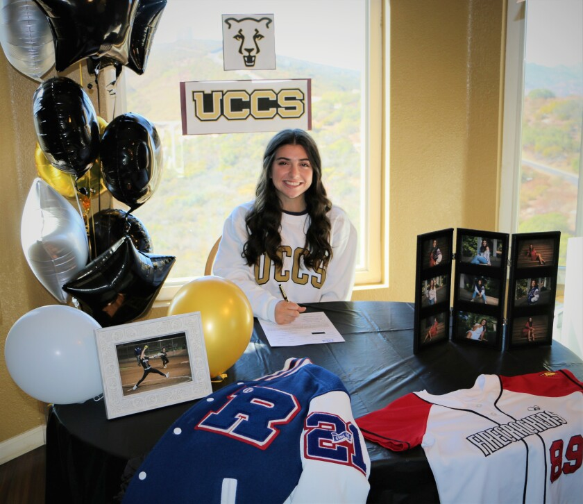 Mackenzie Rutkoff signs her letter of intent to play softball at the University of Colorado Colorado Springs.