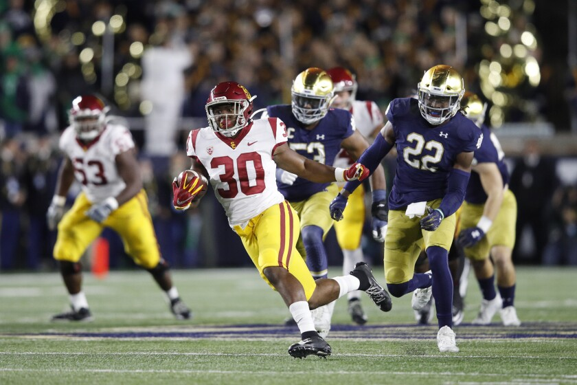 USC's Markese Stepp (30) rushes for a 19-yard gain against Notre Dame in the first half Saturday in South Bend, Ind.
