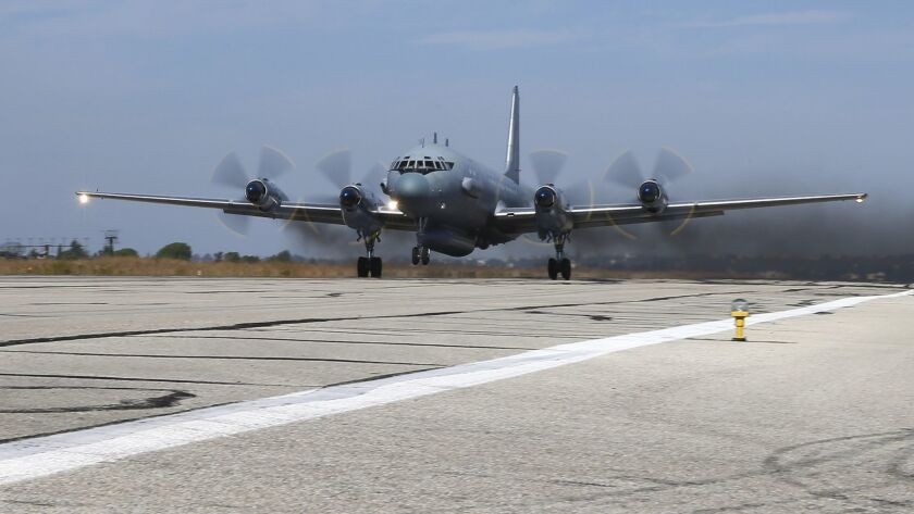 In this 2015 photo, a Il-20 electronic intelligence plane of the Russian air force takes off from the Russian air base in Hemeimeem, Syria. An Il-20 aircraft was shot down Tuesday by a Syrian missile over the Mediterranean Sea, killing all 15 people on board.