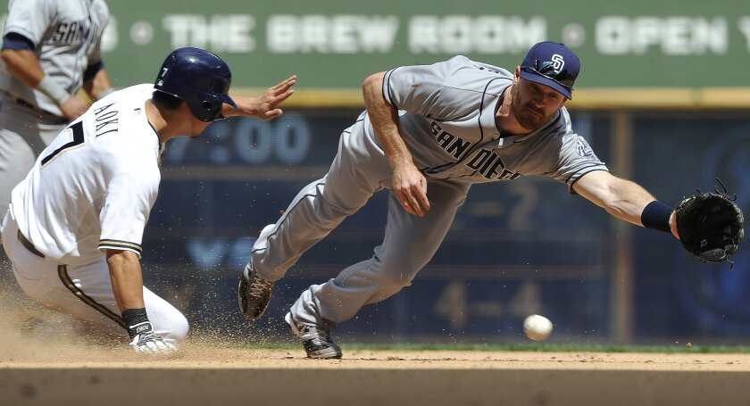 Logan Forsythe reaches for the throw from catcher John Baker as Milwaukee's Norichika Aoki steals second base.