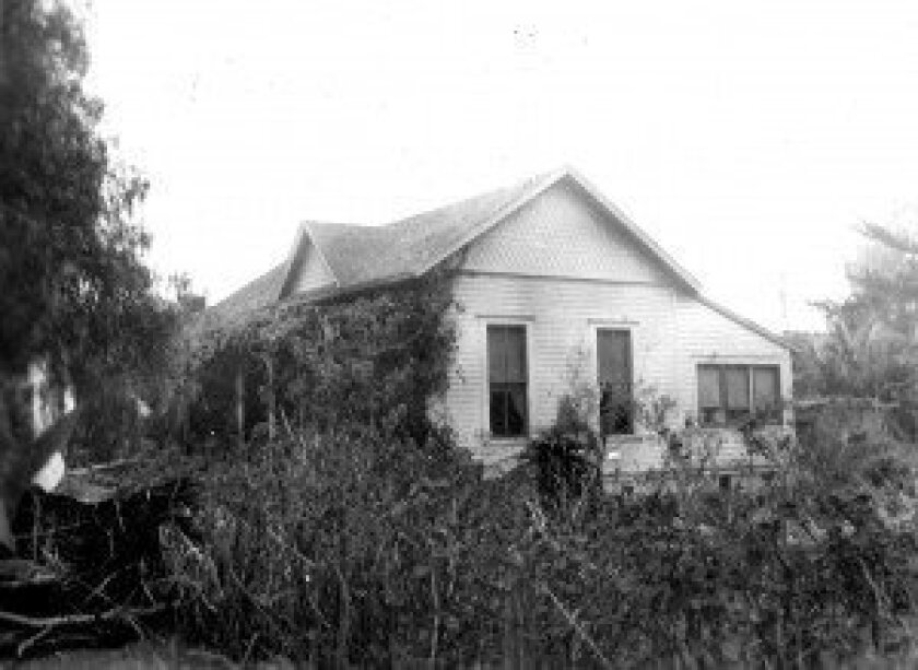 The land where this cottage stood at the corner of Ivanhoe Avenue and Wall Street is now Willis Allen Real Estate company, which is observing is centennial this year. La Jolla Historical Society.