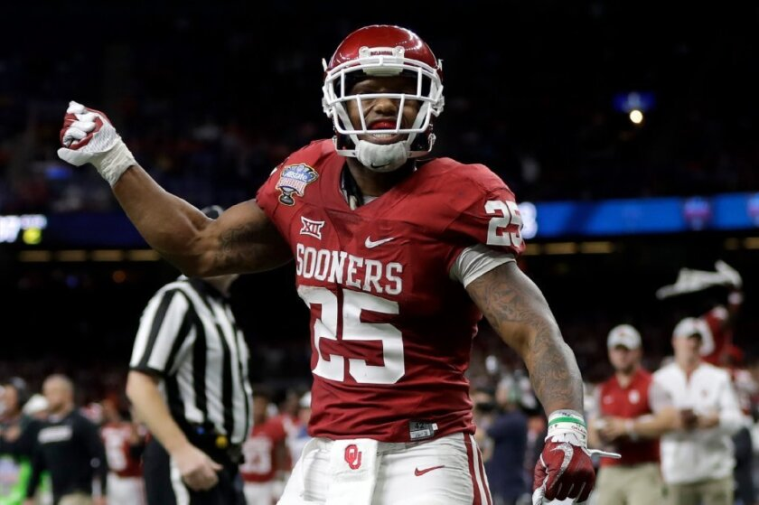 Oklahoma running back Joe Mixon (25) reacts after scoring a touchdown against the Auburn Tigers during the Allstate Sugar Bowl on Jan. 2.
