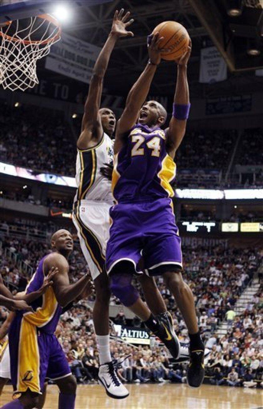 Los Angeles Lakers guard Kobe Bryant (24) goes tot the basket against Utah Jazz forward Jeremy Evans (40) during the first half of their NBA basketball game in Salt Lake City, Friday, April 1, 2011. (AP Photo/Steve C. Wilson)