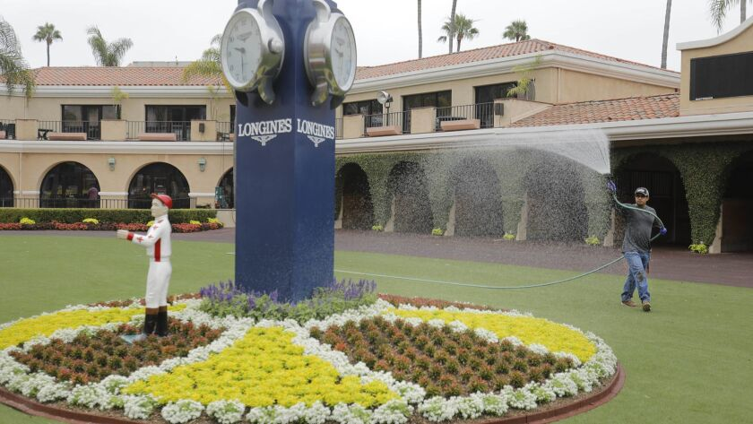 Doroteo Jiames waters the flowers in the center of the paddock area of the Del Mar racetrack as preparation for the beginning of the 2018 racing season, which begins Wednesday, July 18th, is in full swing.