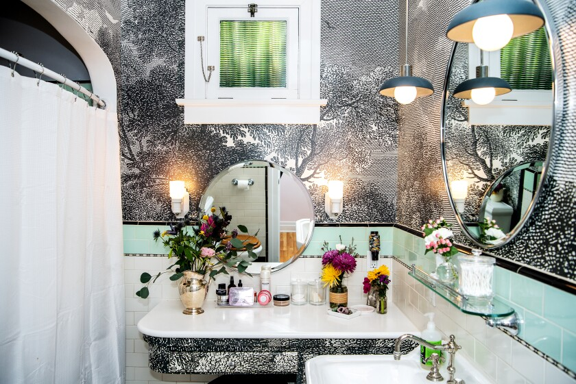 The metallic-wallpapered master bathroom.