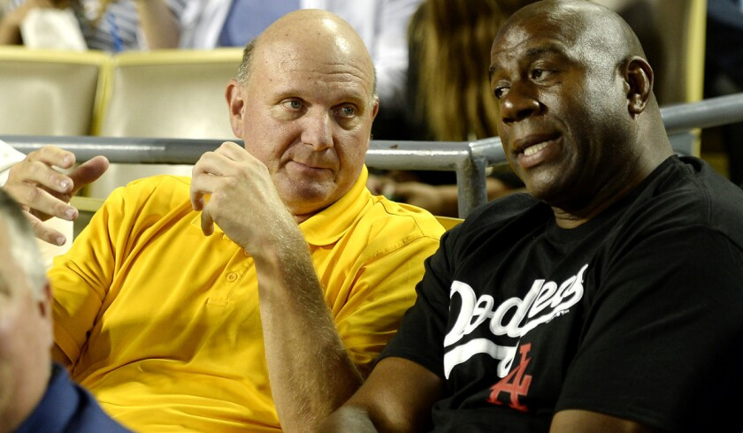 Clippers owner Steve Ballmer takes in a Dodgers game with part owner and former Lakers great Magic Johnson.