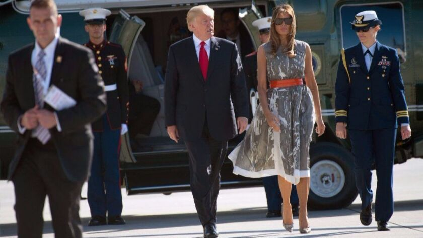 President Trump and First Lady Melania Trump make their way July 8 to Air Force One after the G-20 summit in Hamburg, Germany.