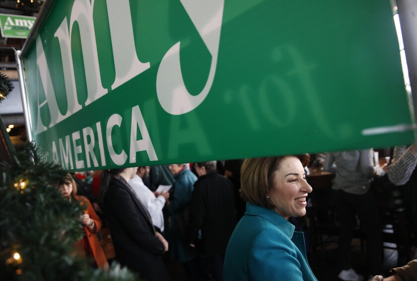 Democratic presidential candidate Sen. Amy Klobuchar, D-Minn., meets with attendees during a campaign event at Crawford Brew Works, Saturday, Feb. 1, 2020, in Bettendorf, Iowa. (AP Photo/John Locher)