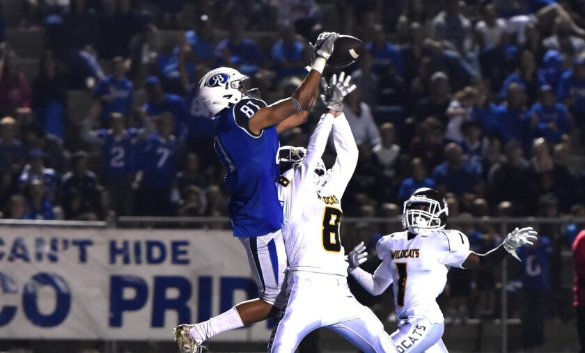 Malcolm Ross-Turner makes a spectacular grab over an El Camino defender for a 30-yard touchdown on Friday night.