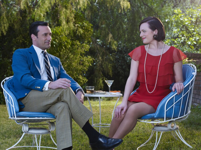 "Jon Hamm as Don Draper, left, and Elisabeth Moss as Peggy Olson. Created by Matt Weiner, the pioneering AMC drama ""Mad Men"" helped AMC establish itself as a destination for high-quality content."