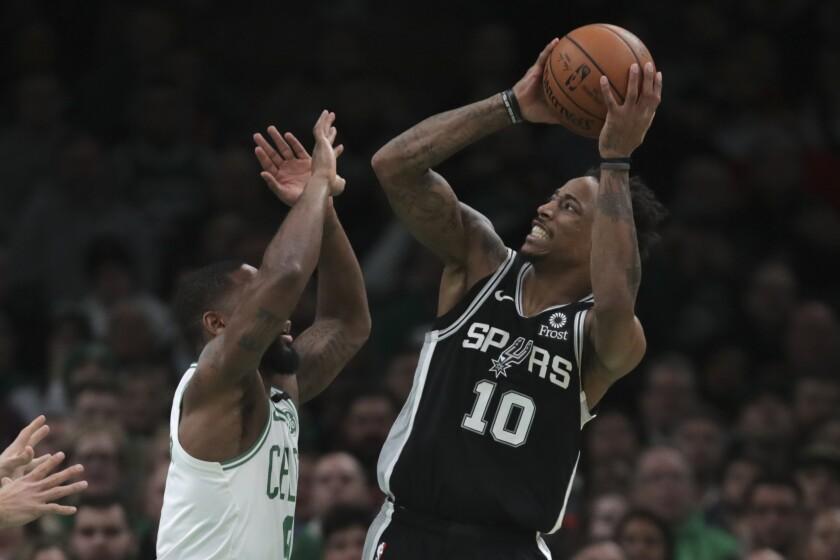 San Antonio Spurs guard DeMar DeRozan (10) shoots over Boston Celtics guard Brad Wanamaker, left, during the third quarter of an NBA basketball game Wednesday, Jan. 8, 2020 in Boston. (AP Photo/Charles Krupa)