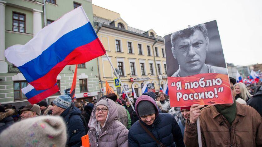 Russians march for Nemtsov