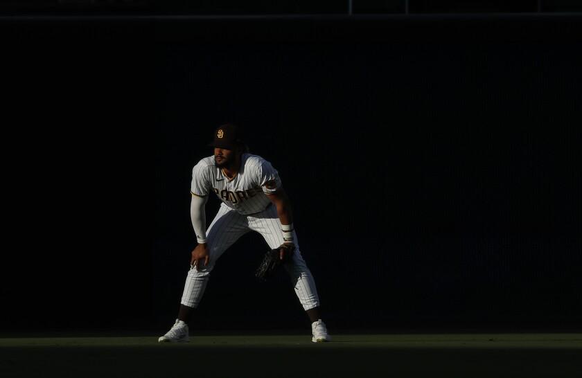 Fernando Tatis Jr. stands in right field