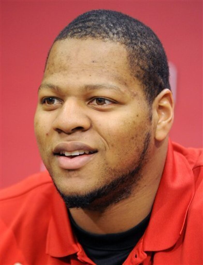 FILE - In this March 24, 2009 photo, Nebraska defensive tackle Ndamukong Suh talks during a NCAA college football news conference at Memorial Stadium in Lincoln, Neb. Suh has been invited to the Heisman Trophy presentation as a finalist, along with Mark Ingram, Toby Gerhart, Tim Tebow and Colt McCoy during an announcement on Monday, Dec. 7, 2009. (AP Photo/Dave Weaver)