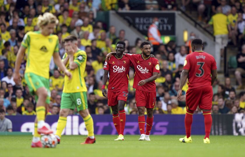 Watford's Ismaila Sarr, center left, celebrates scoring during the English Premier League soccer match between Norwich City and Watford at Carrow Road, Norwich, England, Saturday Sept. 18, 2021. (Joe Giddens/PA via AP)