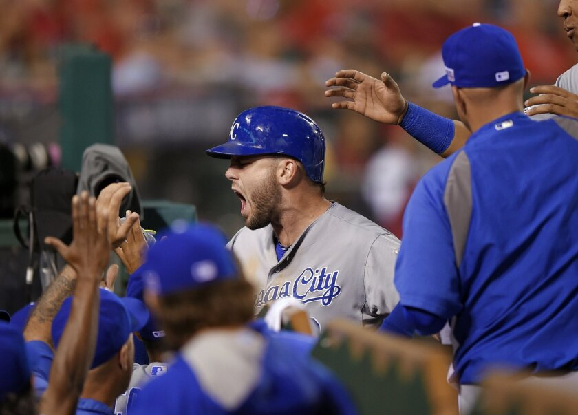 Kansas City Royals' Mike Moustakas celebrates his home run with teammates in the 11th inning against the Los Angeles Angels in Game 1 of baseball's AL Division Series in Anaheim, Calif., Thursday, Oct. 2, 2014. (AP Photo/Mark J. Terrill)