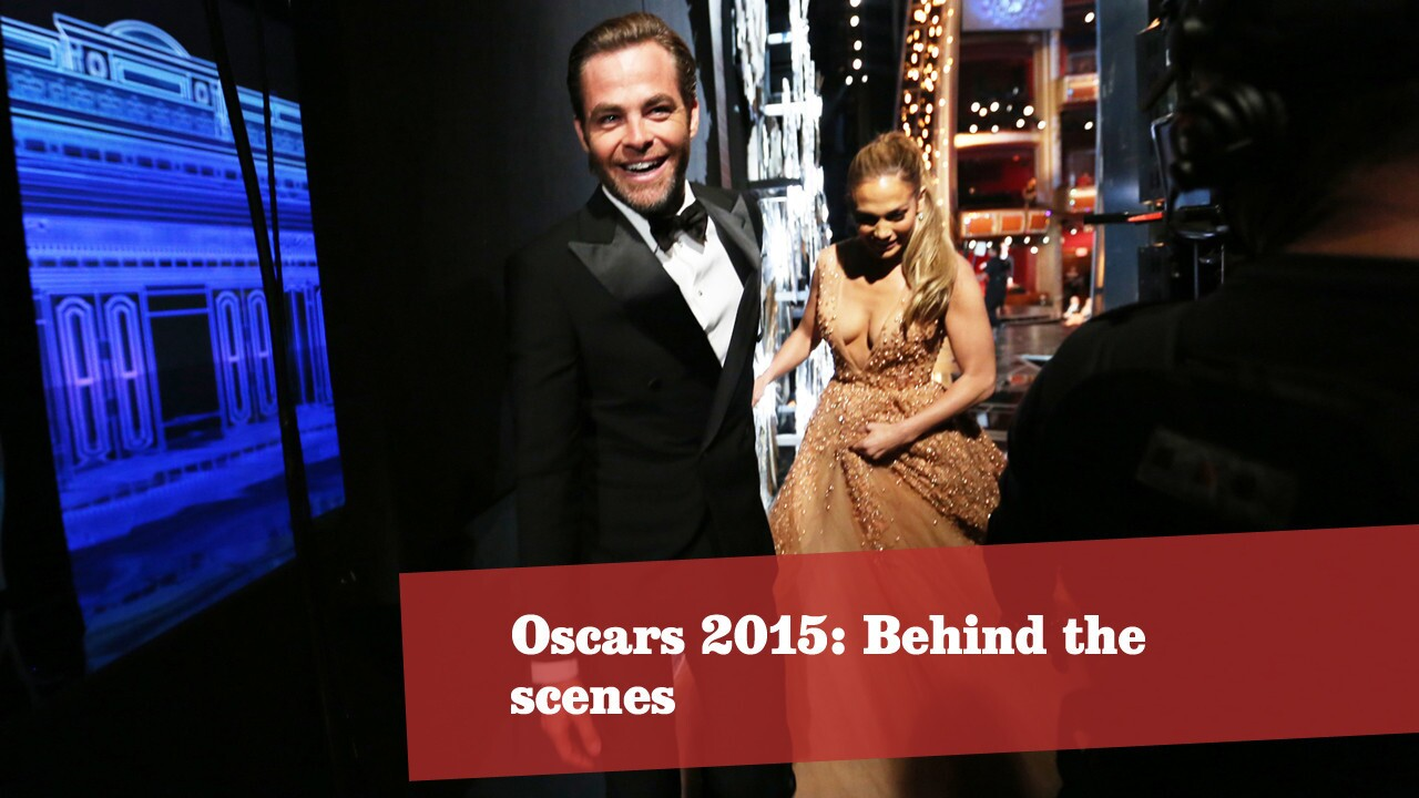 Actors Chris Pine and Jennifer Lopez make their way backstage. The pair presented the award for costume design. More Oscars: Full coverage | Complete list | The show | Red carpet | Quotes | Best & worst | Winners' room | Top nominees | Video Q&As