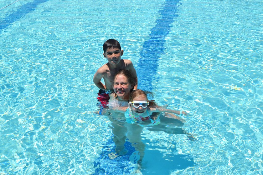 Nora LeFevre with her 10-year-old twins Gavin and Catherine at the Poway Swim Center on Tuesday.
