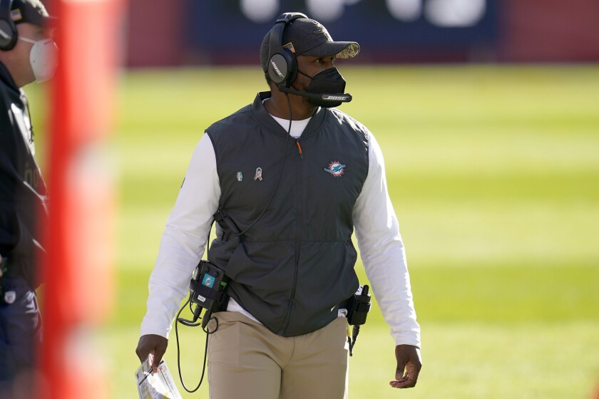Miami Dolphins head coach Brian Flores watches during the first half of an NFL football game against the Denver Broncos, Sunday, Nov. 22, 2020, in Denver. The Dolphins play against the Cincinnati Bengals on Sunday, Dec. 6. (AP Photo/David Zalubowski)