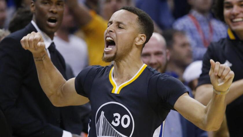 Stephen Curry raises his hands and opens his mouth during a game.