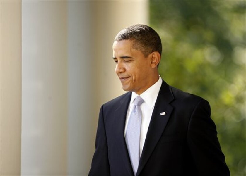 President Barack Obama arrives in the Rose Garden of the White House in Washington, Monday, Oct. 5, 2009, to make remarks on health care reform. (AP Photo/Gerald Herbert)