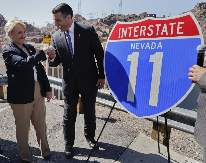 Republican Gov. Brian Sandoval of Nevada, pictured with Arizona Gov. Jan Brewer, has thrown cold water on the prospect of challenging Democratic Senate Majority Leader Harry Reid. But he won't rule it out entirely.