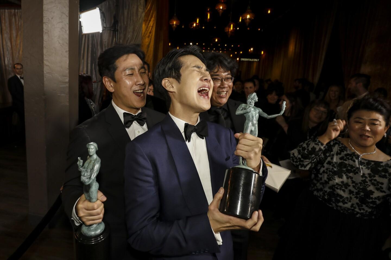 Sun-kyun Lee, Woo-sik Choi, director Bong Joon-Ho, and Jeong-eun Lee backstage at the 26th Screen Actors Guild Awards.
