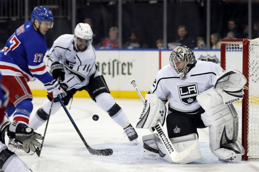 Kings goaltender Jonathan Quick makes a save against the New York Rangers in the second period of a 4-1 loss Sunday.