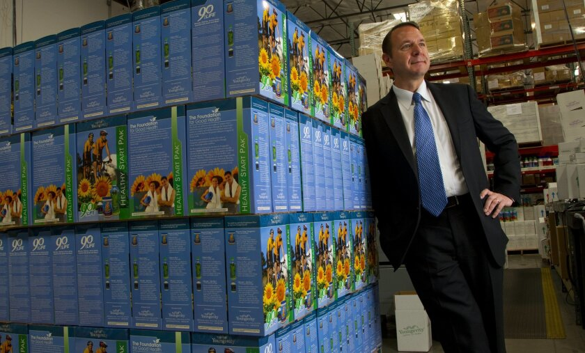 Youngevity CEO Steve Wallach stands in the company's Chula Vista shipping and packaging warehouse where a pallet is ready for shipment.