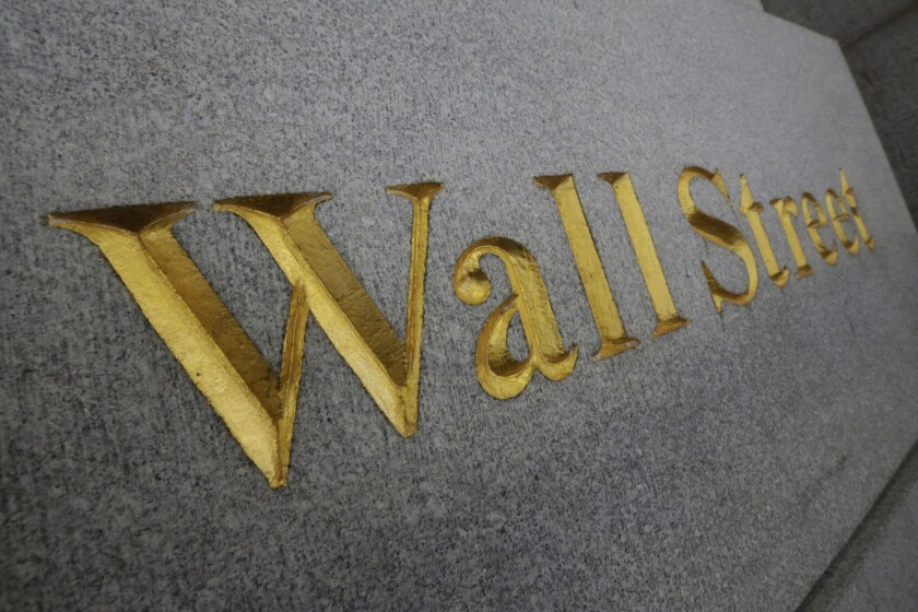 "The  words ""Wall Street"" imprinted in stone."