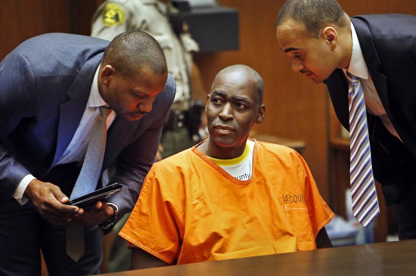 Actor Michael Jace is flanked by his attorneys Peter L. Carr IV, left, and Jason O. Sias during a 2014 proceeding in Los Angeles County Superior Court.