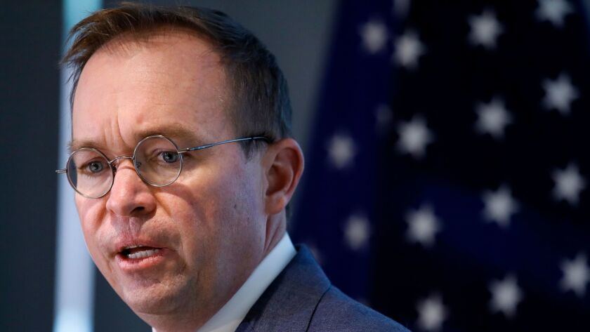 Mick Mulvaney, who is President Trump's budget director, is now also acting director of the Consumer Financial Protection Bureau.