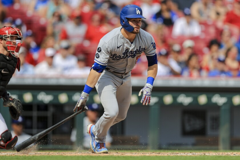 Dodgers' Gavin Lux runs after hitting a two-run triple against the Cincinnati Reds on Sept. 18.
